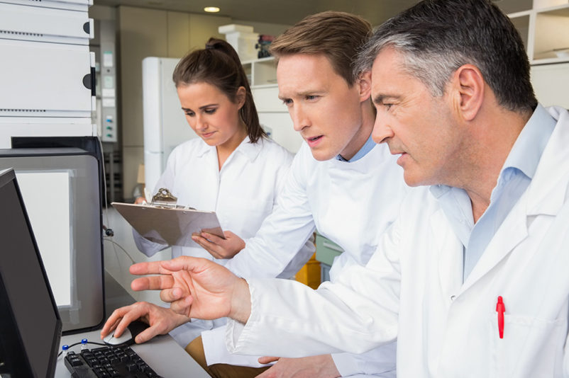 Scientists working together for novel drugs development